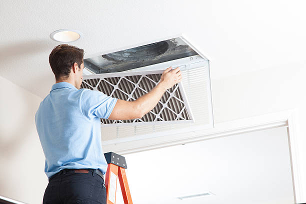 This man is cleaning out the air duct cleaning system